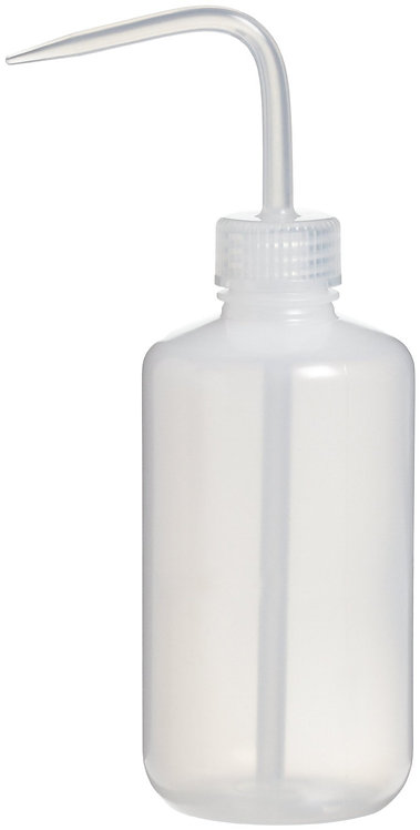 Negative pressure wash bottle