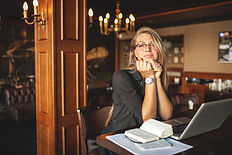A Businesswoman waiting for a client with a Premium Glow Spray Tan provided by Robin at Brushed Artistry in Widermere,FL