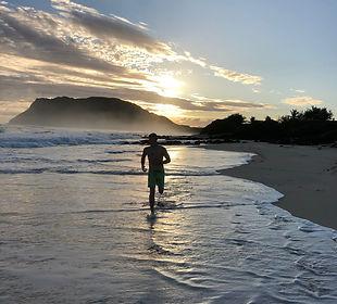 Marine jogging on beach