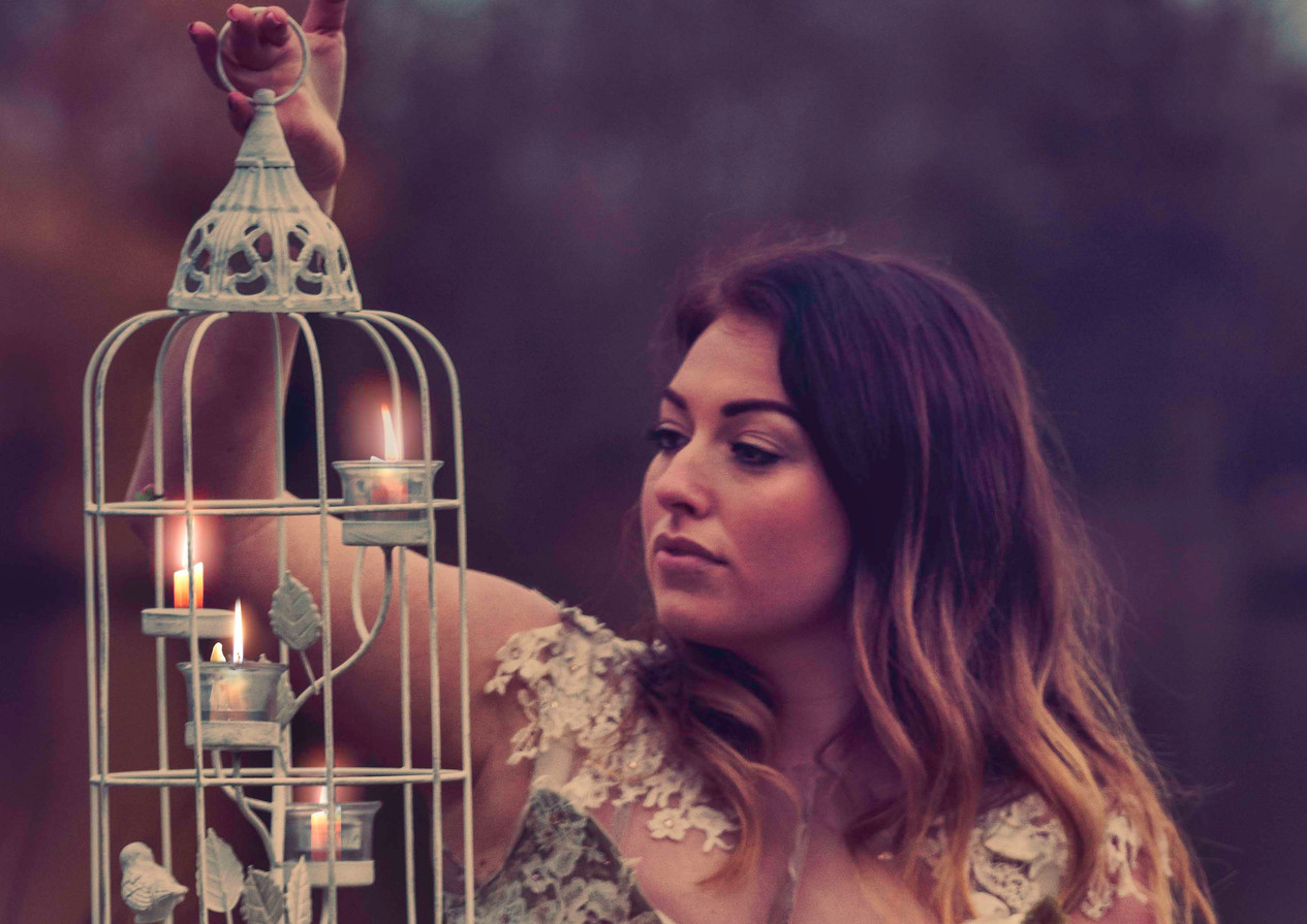girl holding a bird cage portrait