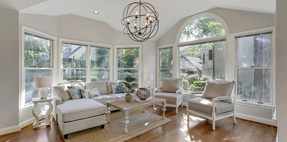 Sunroom with Ample Windows and Orbital Chandelier