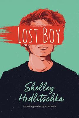 A red-headed boy wearing a black shirt is shown in front of a green background and the words LOST BOY obscure his face