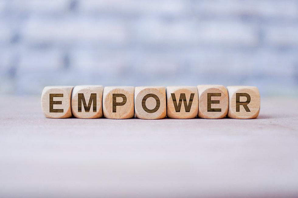 Empower word written on wood block.jpg