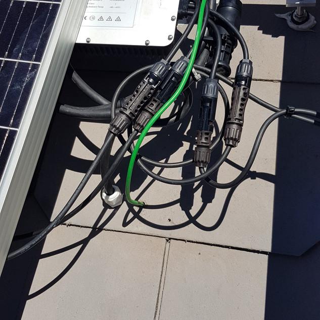 HoyMiles MI-1200 MicroInverter being installed.