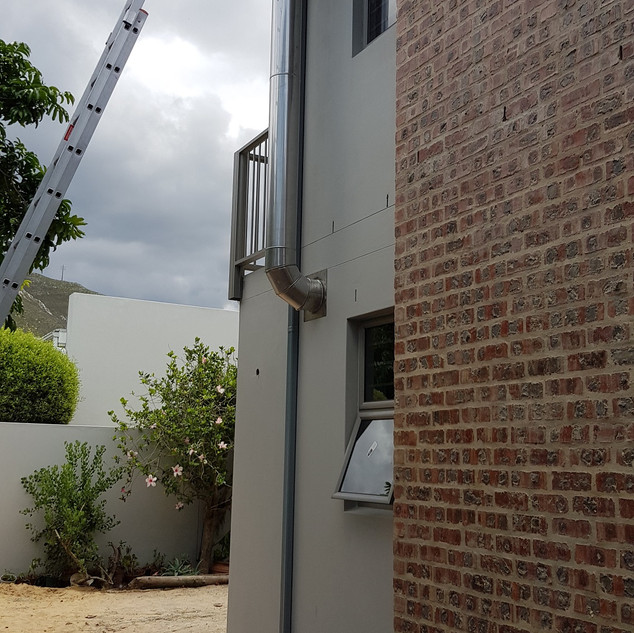 Dove Grey 125mm OOGEE Seamless Aluminium Gutters installed with 50 x 75mm Aluminium Downpipes.