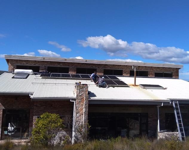 Installation of 16 x 390Wp Solar PV modules.