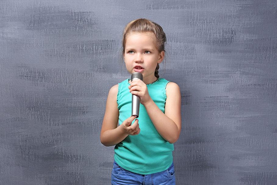 Elementary girl with mic.jpeg