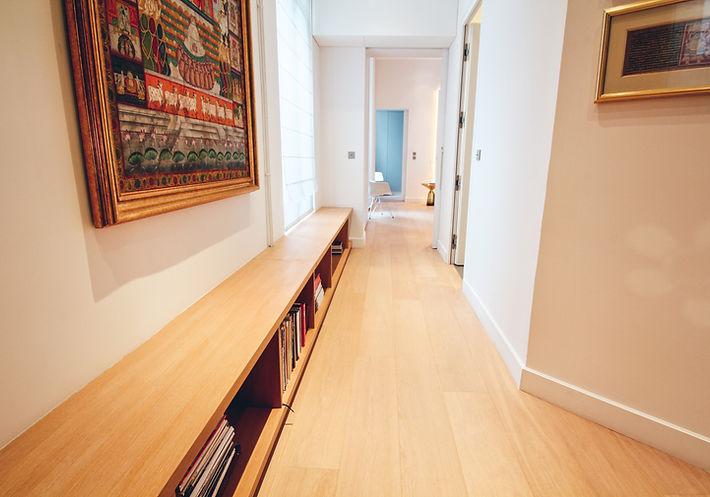 Parental suite hallway, solid oakwood shelving, Krishna painting on silk fabric, India Trocadero, Paris, Christi Rolland Home Interiors