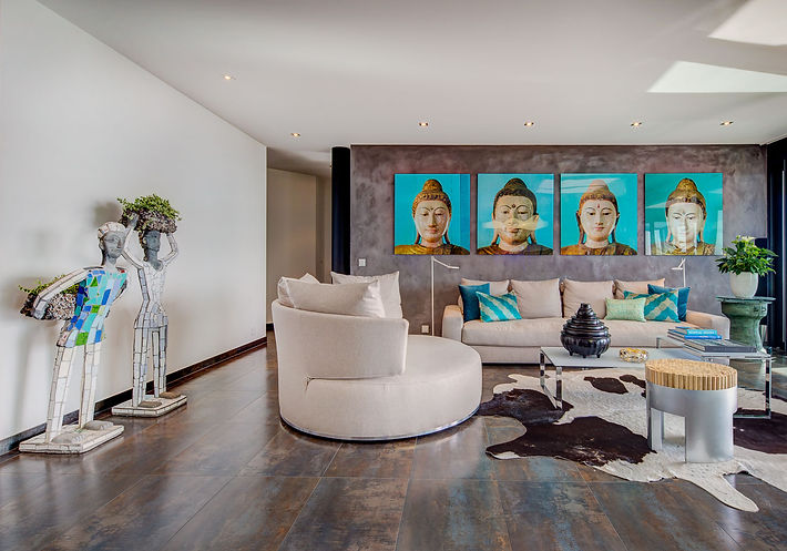 The Blue Living Room, Jagger sofa by Minotti, Amoneus rotating sofa by Maxalto, DUO coffee table by Presotto, Nek Chand statues, Flos floor lamps, large cowhide, Thai buddhas photographs, Lake Geneva, Christi Rolland Home Interiors