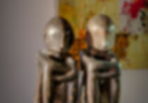 Antique Bulul rice gods from Ifugao tribes, Philippines, Ivan Acuna abstract paintings in background, Lake Geneva, Christi Rolland Home Interiors