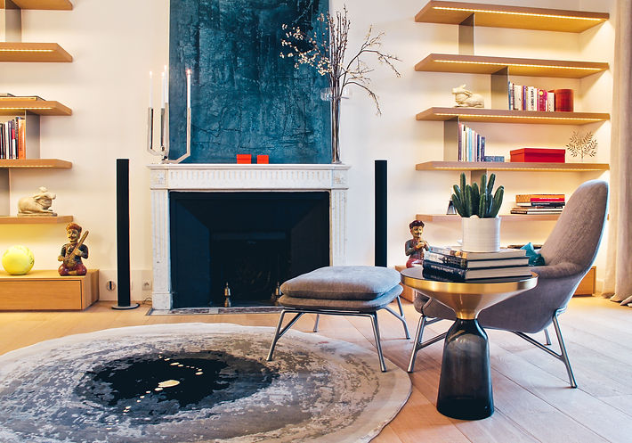 The Bibliotheque Room, BELL side table grey quartz, natural oakbuilt-in solid oakwood with stainless steel panels and LED-lighting bookshelves, Christofle candlestand, round carpet PERCUSSION by Min Jung Kim, PRINCE armchair and poof by Minotti, natural wax finish oak parquet by Oscar Ono, Trocadero, Paris, Christi Rolland Home Interiors