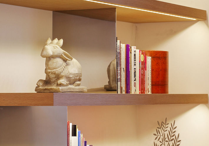 Bibliotheque details, solid oakwood and stainless steel dividers, old marble cow statue, India, Burmese lacquer box, Trocadero, Paris, Christi Rolland Home Interiors