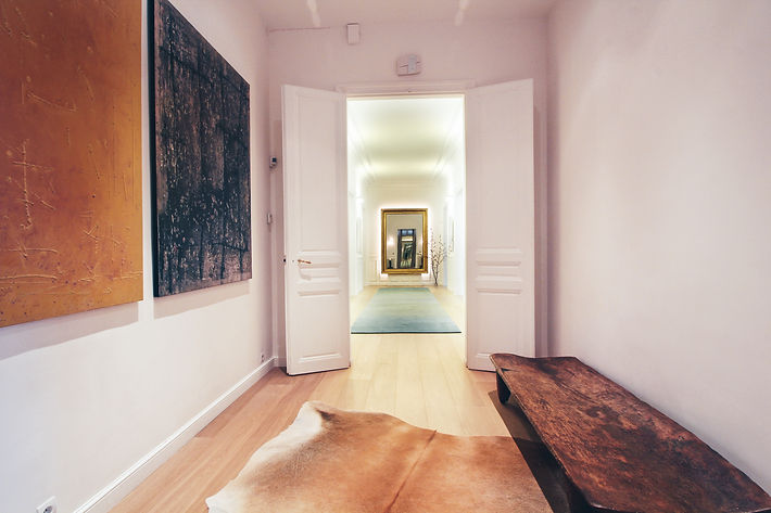 The Gallery, Oscar Ono parquet, 19th century gold leaf framed mirror, woolen carpet runner by SAHRAI MILANO, abstract oil paintings, antique Nagaland wooden bed, cowhide, Trocadero, Paris, Christi Rolland Home Interiors