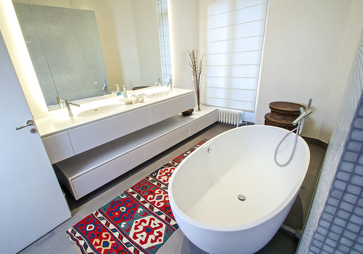 The Master Bathroom, blinds by RUE HEROLD, beveled mirror with LED back lighting, handwoven antique Turkish kilim, Corian sinks and shelving, Corian oval free-standng bathtub, mosaic tiles from Surface, Paris, Hansgrohe bathrom fittings, porcelain tiles from Surface, Paris, Ifugao handwoven baskets from the Philippines, Trocadero, Paris, Christi Rolland Home Interiors