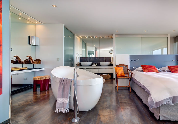 The Master Bedroom and Spa, antique wooden horse saddle from Cotabato, Villeroy & Boch bathtub, Chiquita red metal an bamboo stool by Kenneth Cobonpue, antique Chinese folding wooden chairs, Lake Geneva, Christi Rolland Home Interiors