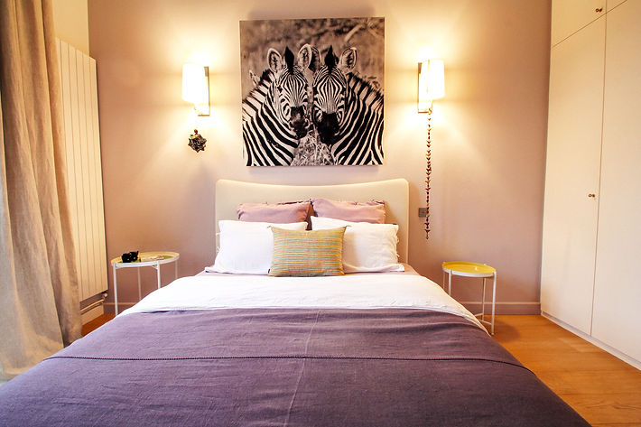 The Purple Wall Room, bed linens and cushions by Caravane Paris, African zebras digital print wall decoration, Trocadero, Paris, Christi Rolland Home Interiors