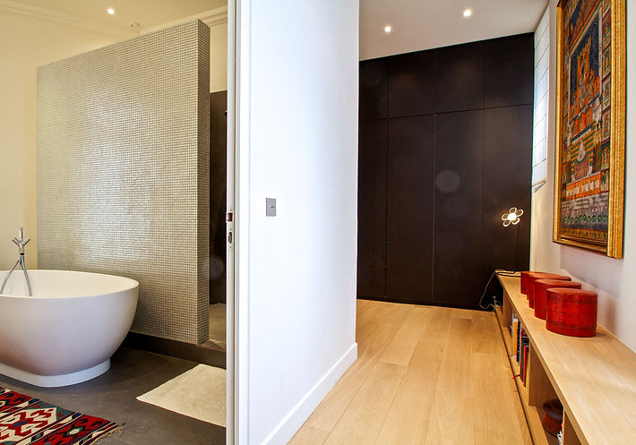 The Hallway, Parental Suite, Indian Krishna painting on silk fabric, Burmese boxes, Oscar Ono oak and wax finisparquet flooring, bathroom open divider wall of mosaic tiles, stand-alone oval bathtub in Corian, Hansgrohe bathroom fittings, Trocadero, Paris, Christi Rolland Home Interiors