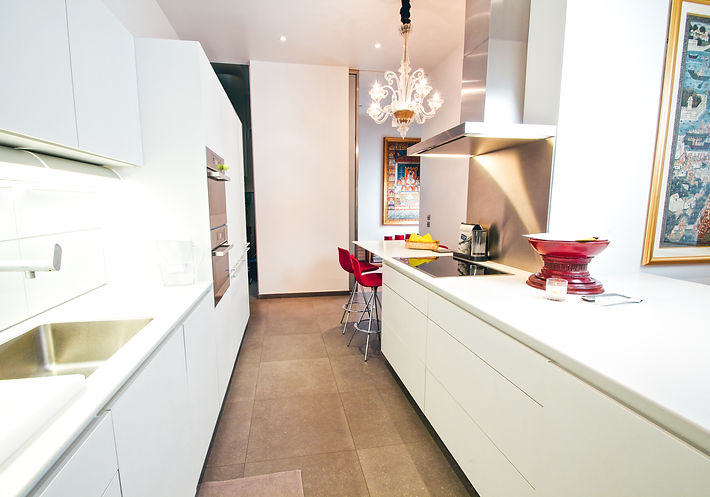Bulthaup kitchen, Miele appliances, Gaggenau refrigerator, 1940 Murano cut glass chandelier, stool LOTTUS by Enea Design, porcelain tiles from Surface, Trocadero, Paris, Christi Rolland Home Interiors