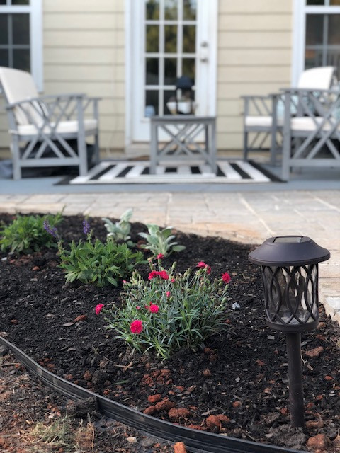 Transformation: Flower beds around patio