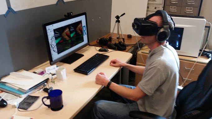 Piotr and Kevin Corbett (pictured) touring a 3D Virtual Reality lab at UCSD.