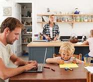 Young white family of four busy in their