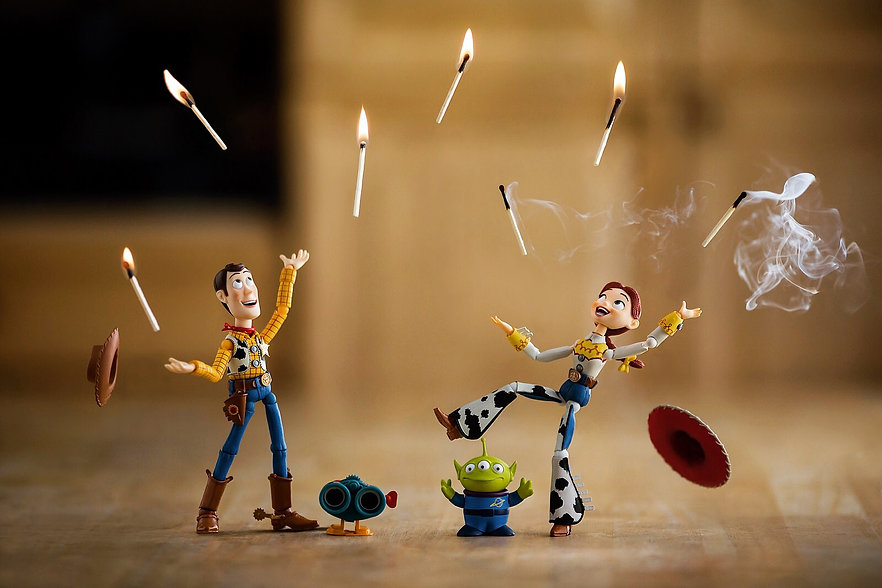 Woody and Jessie juggle lit matches