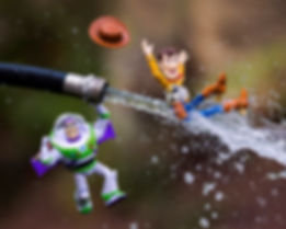 Buzz Lightyear and Woody play with garden hose water