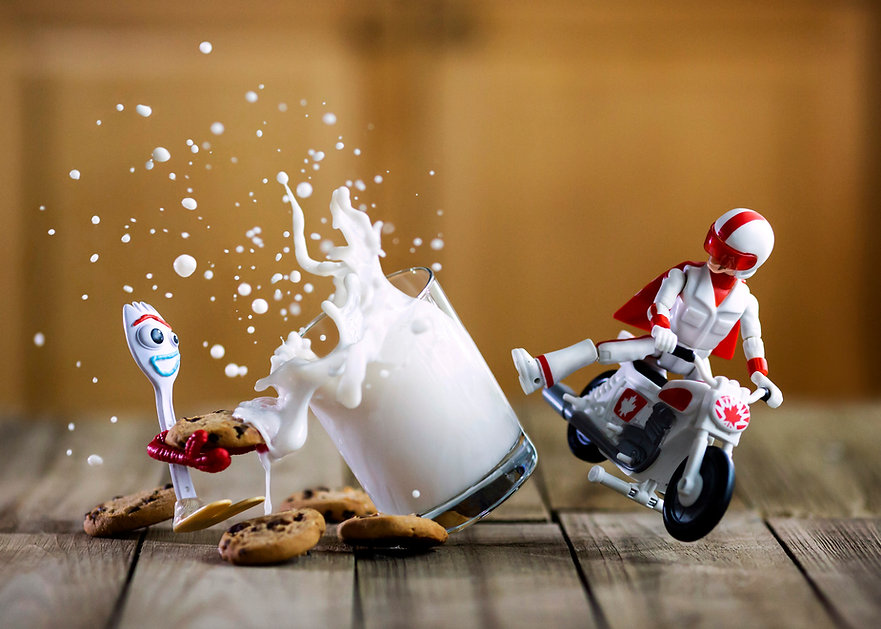 Toy Story Duke Caboom kicks glass of milk onto Forky's cookie