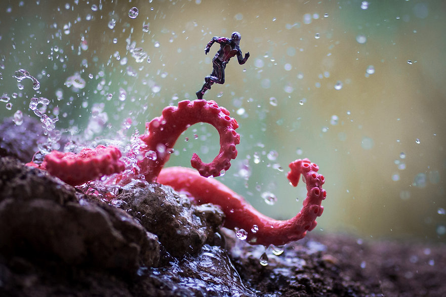 Ant-Man runs on octopus tentacles with water splashing