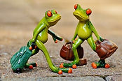 two-figurines-of-frogs-carrying-luggage.