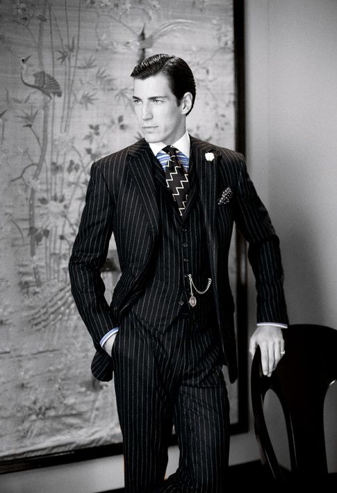 Eugene in a pinstriped suit