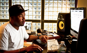 Ski Beatz working at a desk on music production