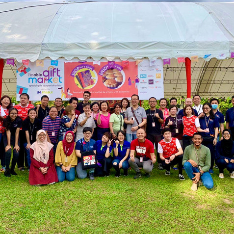 Group Photo of All Who Participated in the i'mable Gift Market at the Istana Open House