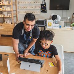 Amin from Tinkle Arts teaching a boy digital design
