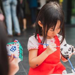 A little girl painting a panda