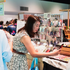 A shopper taking photo of the merchandise on display
