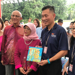 President Halimah Yacob poses for a photo with staff from Cerebral Palsy Alliance Singapore