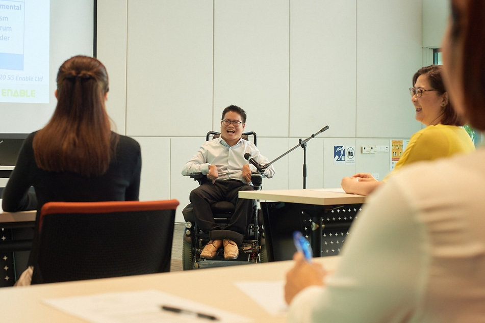 Photo shows SG Enable Inclusion Champion conducting a Disability Awareness workshop.