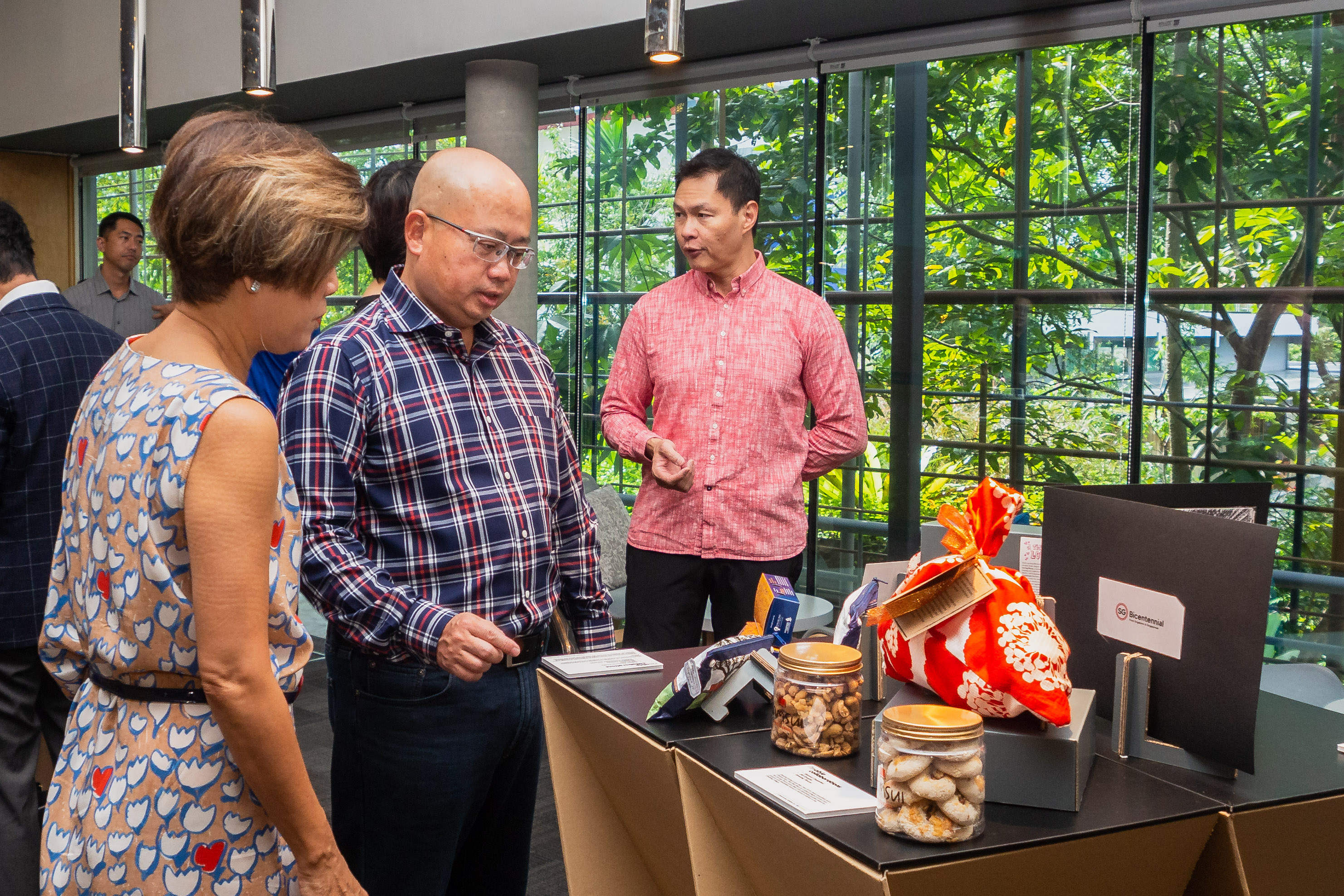 Ms Kan Shook Wah and Mr Yeo Phee Teik admiring items on display