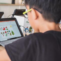 A boy learning digital design