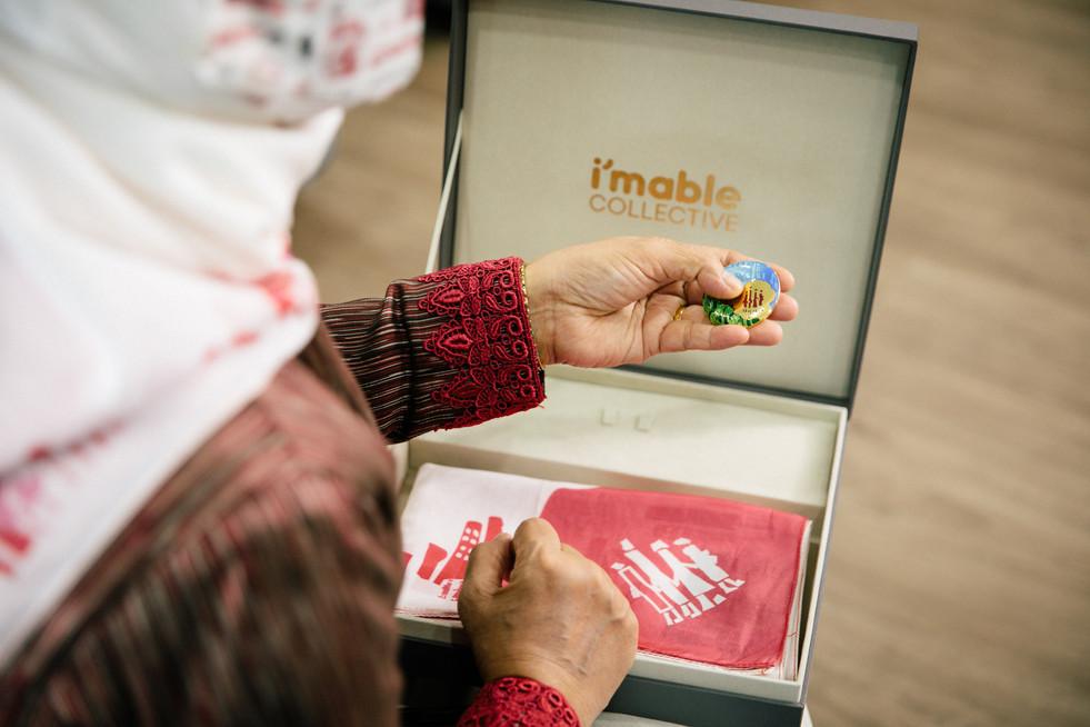 President Halimah Yacob admiring the enamel brooch