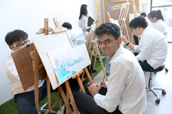 Artists smiling at the camera