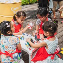 A group of girls making handicraft