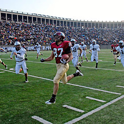 Marco Iannuzzi returning kickoff for TD in Harvard vs Yale 127th edition