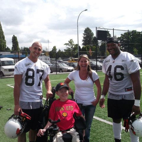 Marco Iannuzzi with Rolly Lumbala hang out after practice with lifetime Lions supporter and friend Brenden