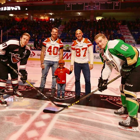 Marco Iannuzzi, son, and Mike Benson drop the puck at the Vancouver Giants WHL game