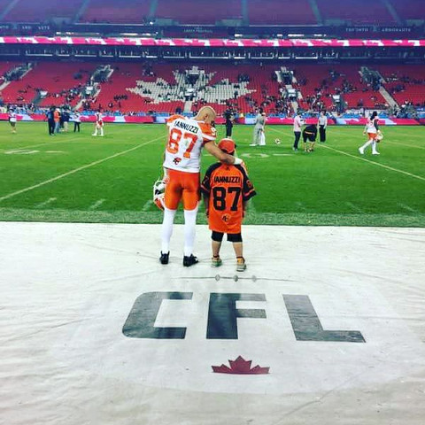 Marco Iannuzzi invites fan wearing his jersey on to the field post game