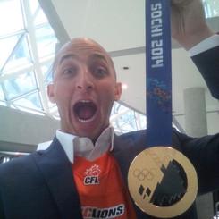 Marco Iannuzi with Canadian Hockey legend Gillian Apps' Sochi Olympics Gold Medal