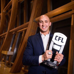 Marco Iannuzzi receiving CFL's Tom Pate Memorial Award for community service