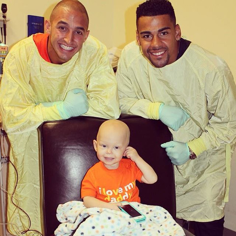 Marco Iannuzzi with Andrew Harris bringing smiles to BC Children's Hospital